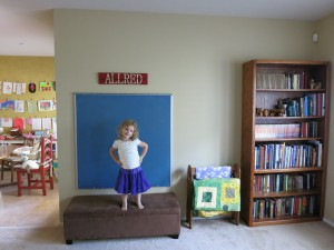 Anna in front of the chalkboard the day we hung it on the wall.